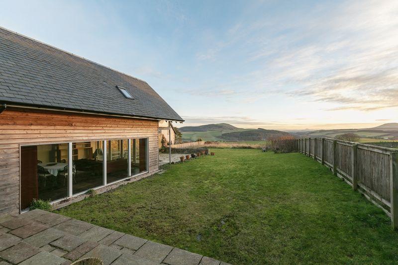 Huntshaw Cottage garden and view